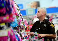 Police officers, deputies pick presents with children in need