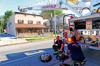 Greenfield business, apartment building damaged in fire