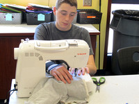 Students up-cycle T-shirts to make diapers for kids in Haiti