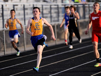 Boys county track - Cougars put it all together for title